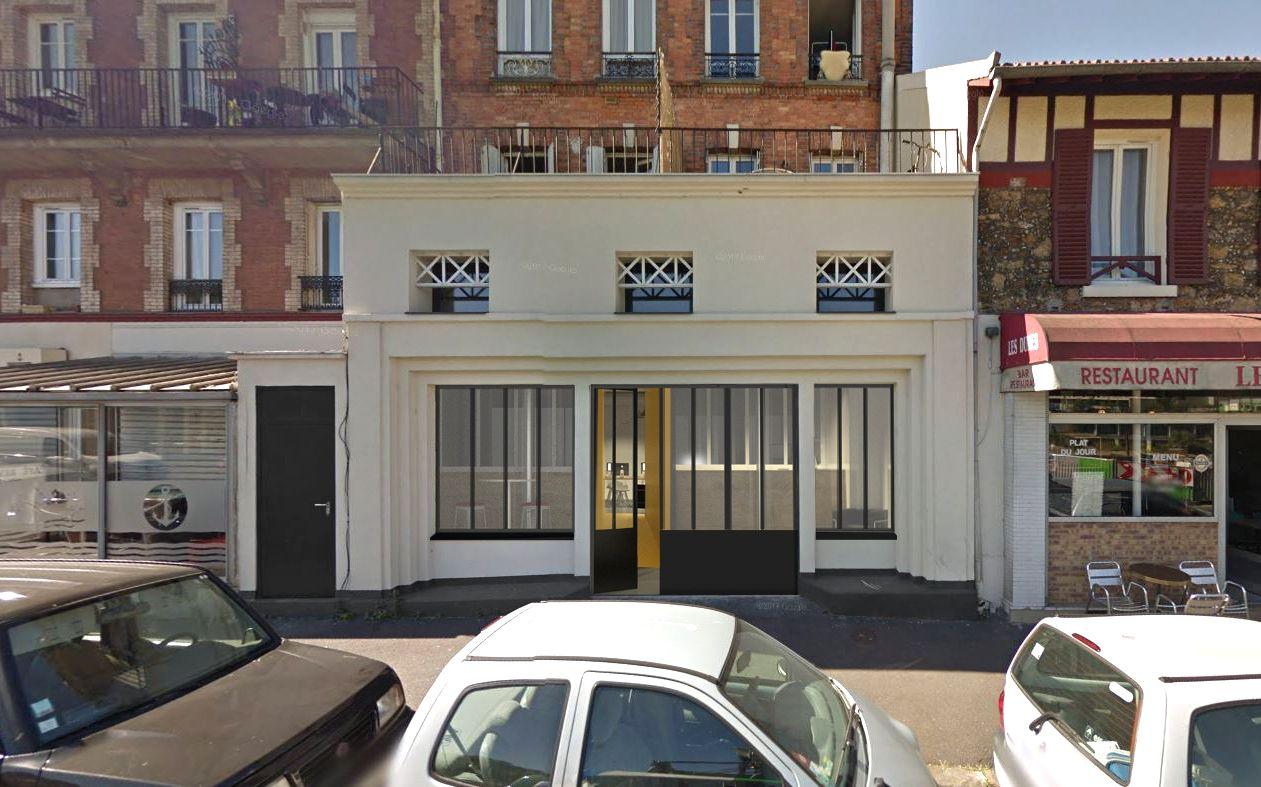 Perspective de la façade d'un bâtiment commercial à Alforville, ancien cinéma et imprimerie